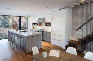 from-the-dining-room, Remodelista: Best Kitchen Space, Stripped down but not too modern for a family in Brownstone Brooklyn who spends most of their time in the kitchen--or outside.