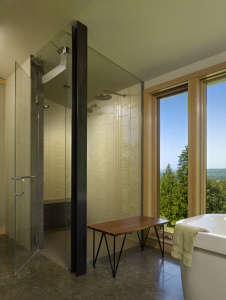 shower-has-built-in-bench-and-celadon-tile-walls, Remodelista: Best Bath Space, The Bath is cantilevered out from a farmhouse, with sweeping views and natural light.  Custom steel vanity mirrors have integral LED lighting. The tub is perched in front of f