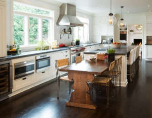 Soapstone-countertops,-and-full-height-pantry-stor, Remodelista: Best Kitchen Space, Create an inviting, comfortable, clean, organized kitchen to function as the center of the home for entertaining, with easy access to the outside.  By organizing living s