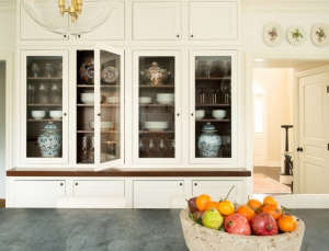 Full-height,-glass-front-cabinets-for-both-conceal, Remodelista: Best Kitchen Space, Create an inviting, comfortable, clean, organized kitchen to function as the center of the home for entertaining, with easy access to the outside.  By organizing living s