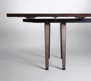 Detail-of-custom-dining-table.--Legs-are-steel-wit, Remodelista: Best Dining Space, Dining space is open to the kitchen and separated from the living  by a stone fireplace.  Original terrazzo floor was re-finished.  A new weathered steel wall with suspend