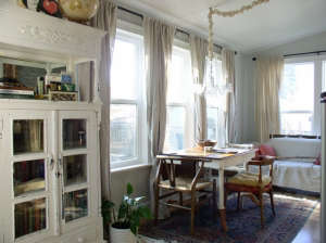 Dining-area-and-windows-to-the-garden, Remodelista: Best Dining Space, I turned a poorly constructed eye sore add-on into a refreshing dining space leading from the kitchen to the back garden.  The main house is a charming two-story, built in 1912 with a