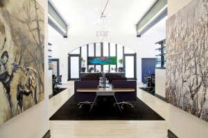 Office-Entry-Custom-Furniture-and-Art, Remodelista: Best Office Space, When I first walked into this space I saw high school gym floors, 90's office furniture, hideous carpeting and red walls...a fun challenge. In 6 months I turned the space into a modern