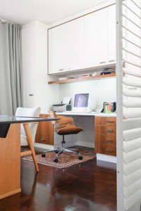 Home-office, Remodelista: Best Office Space, A small back room was converted to a home office, which was opened up to create a spacious feel, but can be closed off with shuttered sliding panels at the end of a working day.