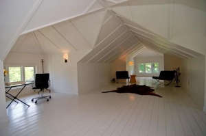 The-raw-attic-had-4-symmetrically-placed-dormers-t, Remodelista: Best Office Space, In this 1914 bungalow renovation, an unfinished attic is converted to a dreamy writer's loft with a full bath tucked into a dormer.