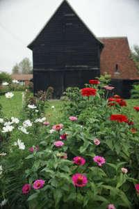 Black barns at Ulting Wick garden, Essex. Gardenista