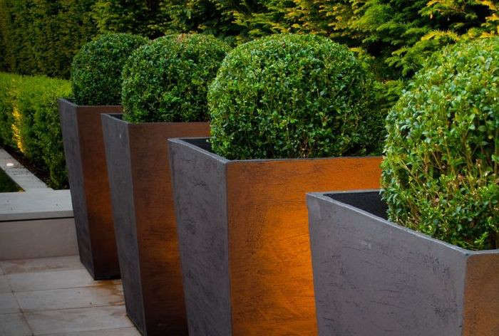 Bronze-Tall-Planters-in-row-Gardenista