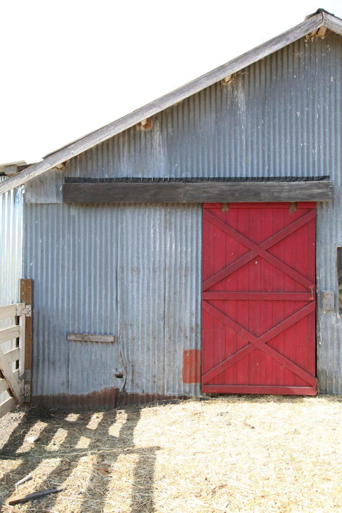 Corrugated Barn with Red Painted Barn Door, Gardenista
