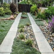 Low-Maintenance-Landscaped-Ribbon-Driveway-Gardenista-1