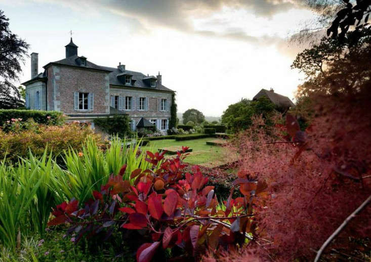 Normandy house with red foliage by Eric Sander