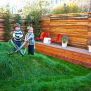 San Francisco Backyard by Creo with Rolling Lawn and Wood Benches