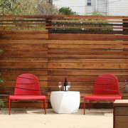San Francisco Garden with Red Outdoor Lounge Chairs