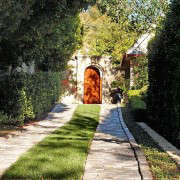 Traditional-Stone-Grass-Ribbon-Driveway-Gardenista