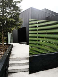 Curb Appeal green horizontal slat fencing ; Gardenista