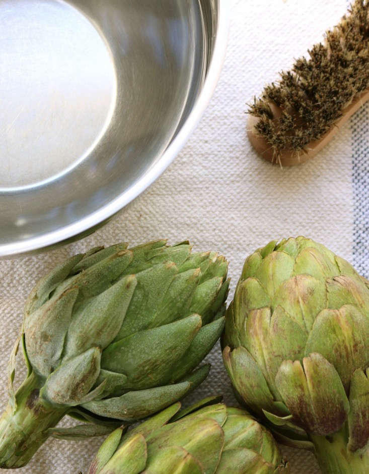 Wash artichokes with a scrub brush and cold water, Gardenista
