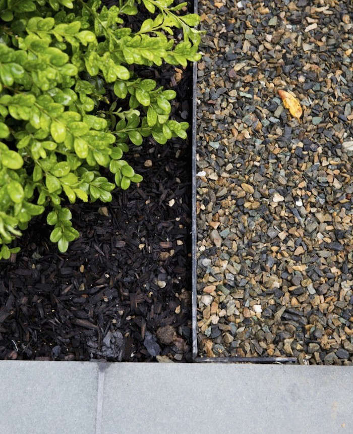 Brick Around Shed With Mulch And Flowers: Hardscaping 101: Metal Landscape Edging