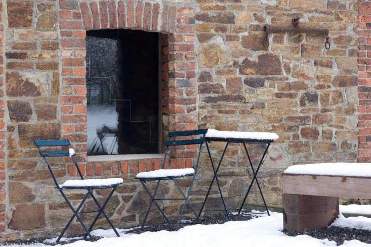 belgian-stone-outbuilding-bistro-chair-table-snow-gardenista