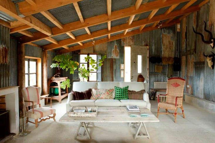 cabin-france-corrugated-metal-living-room-isabel-lopez-quesada-gardenista
