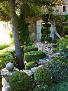 upper terrace nicole de vesian garden cloud pruning boxwood topiary; Gardenista