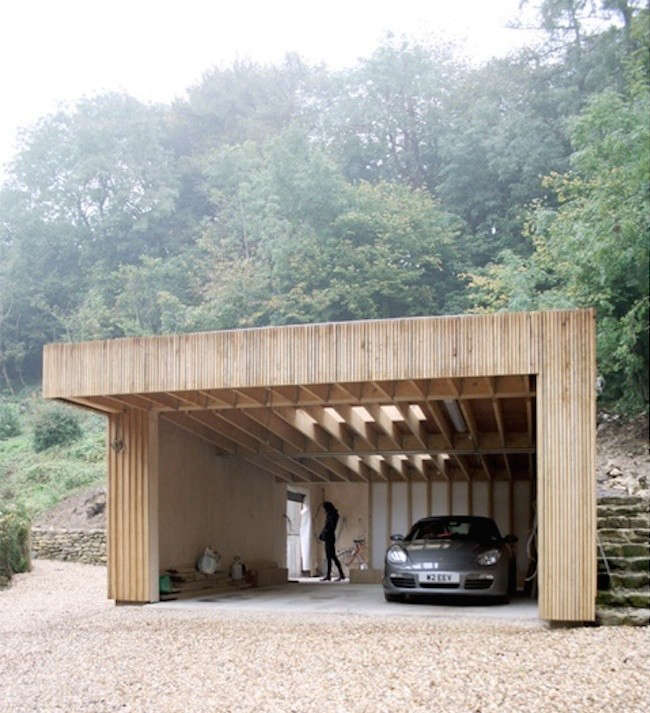 Upstairs downstairs a workshop and garage hidden in a for Hillside garage plans
