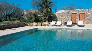 Swimming pool and deck and umbrella at Finca Son Gener on Mallorca