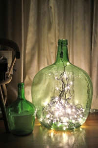 MEssy holiday string lights in a green jar l Gardenista