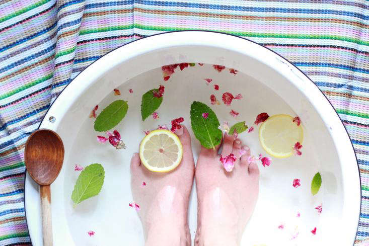 herbal foot soak with feet and spoon