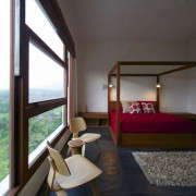 house-cast-in-liquid-stone-with-bedroom-featured-canopy-wood-bed-by-spasm-design-architects