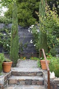 Curb Appeal black horizontal slat fencing ; Gardenista