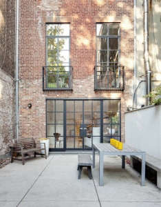 Steel windows NYC townhouse garden courtyard patio ; Gardenista