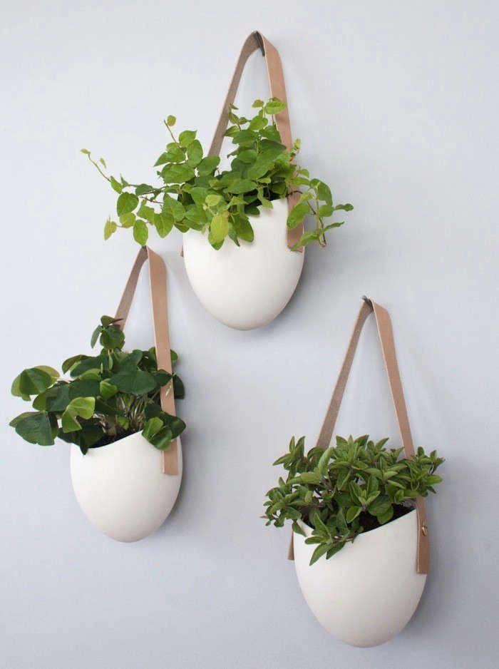 white-hanging-planters-leather-hangers-gardenista