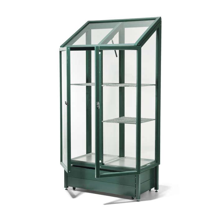 Glass and pinewood balcony greenhouse gardenista