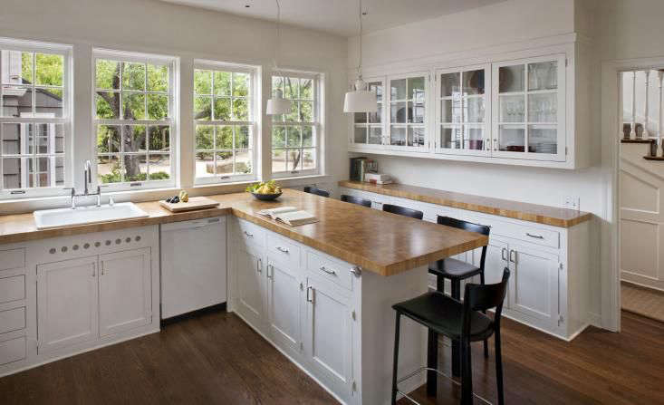 White Traditional Kitchen With Butcher Block Countertops