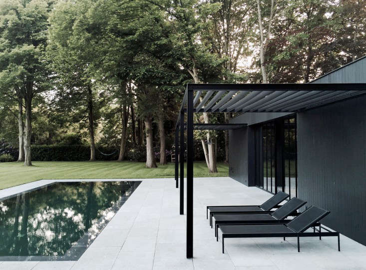 COPP_POOLHOUSE_Merckx_black_steel_pergola_chaise_loungers_patio_terrace_Gardenista
