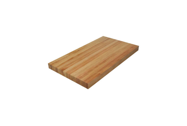 Face-grain butcher block is constructed from boards that are laid flat, their full widths forming a surface with a streamlined look. Susceptible to marks when used for chopping and cutting, face grain is less suitable for working kitchen counters than the others.