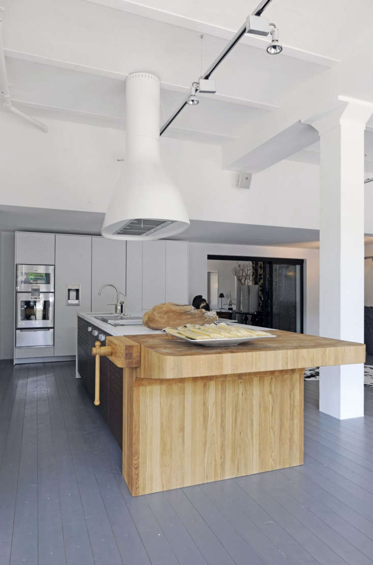 Italian kitchen designers Schiffini use end-grain butcher block at the end of a kitchen island.