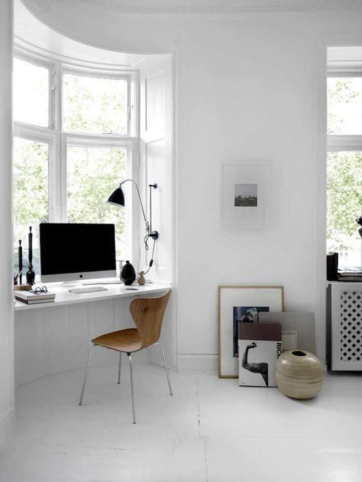 a window desk in an apartment in denmark via lowe home. 21