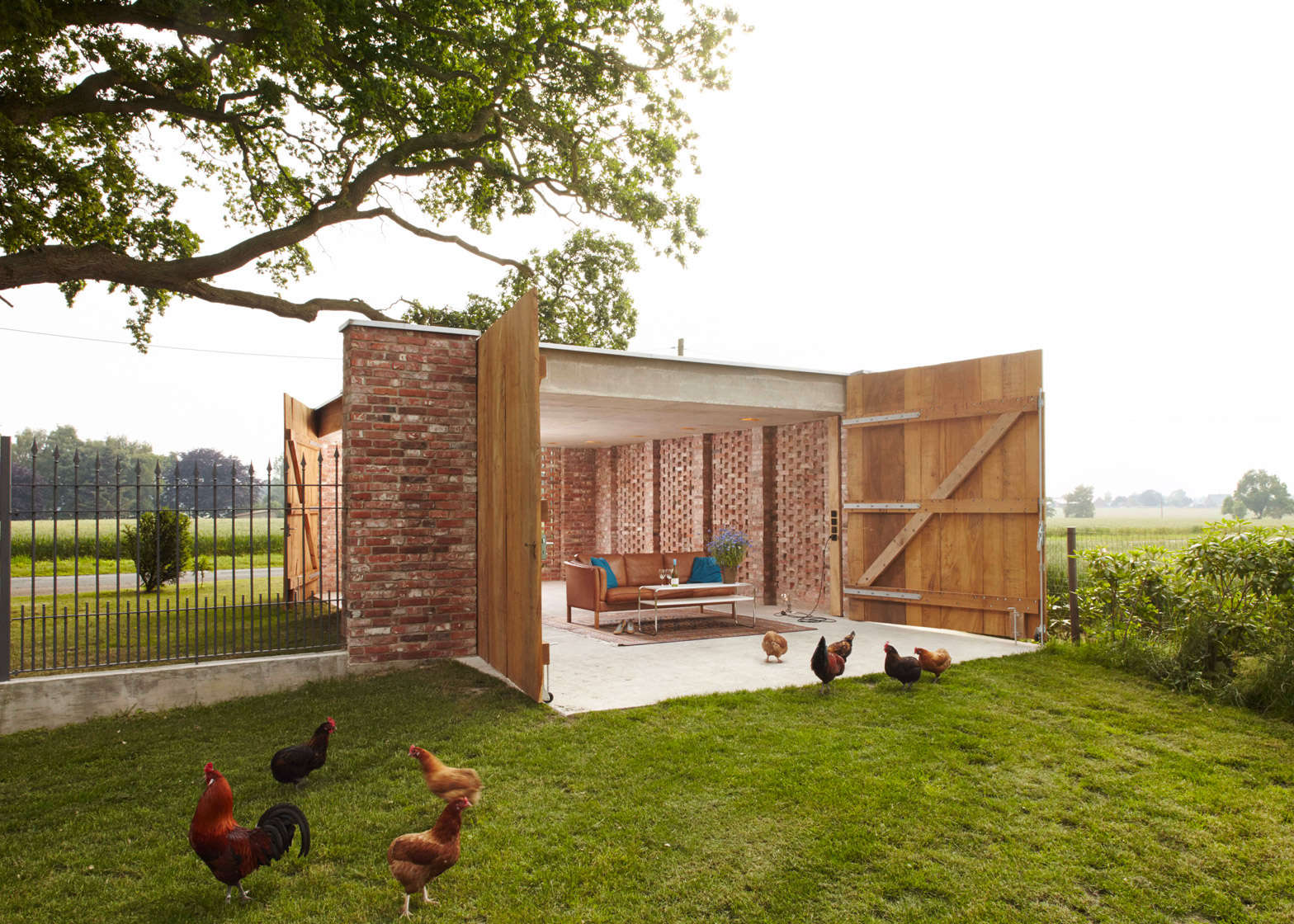 Outbuilding of the week garage as lantern in the german for Brick garage designs