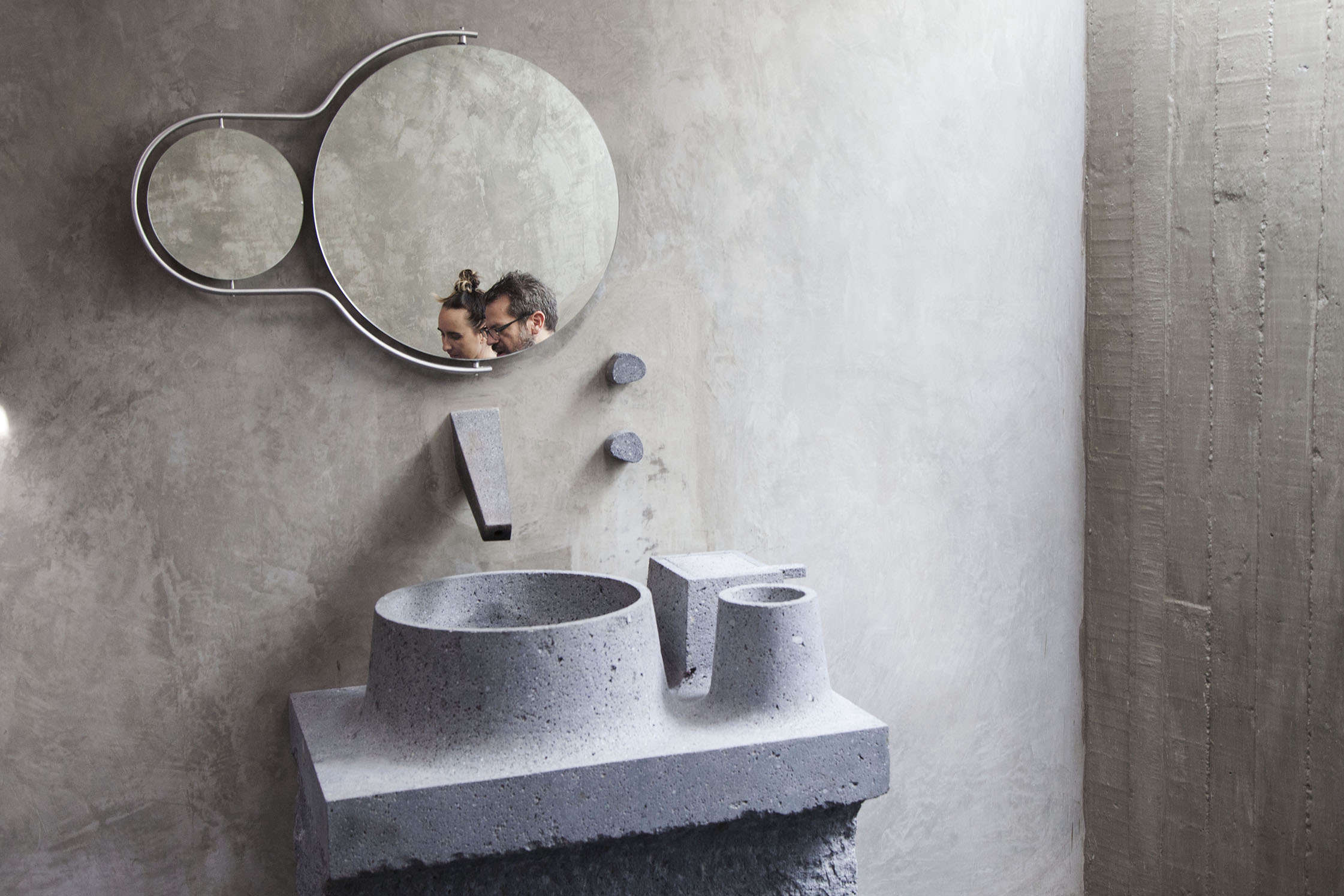 Caste concrete bathroom sink in Pedro Reyes and Carla Fernandez's Brutalist house in Mexico City via FvF | Remodelista