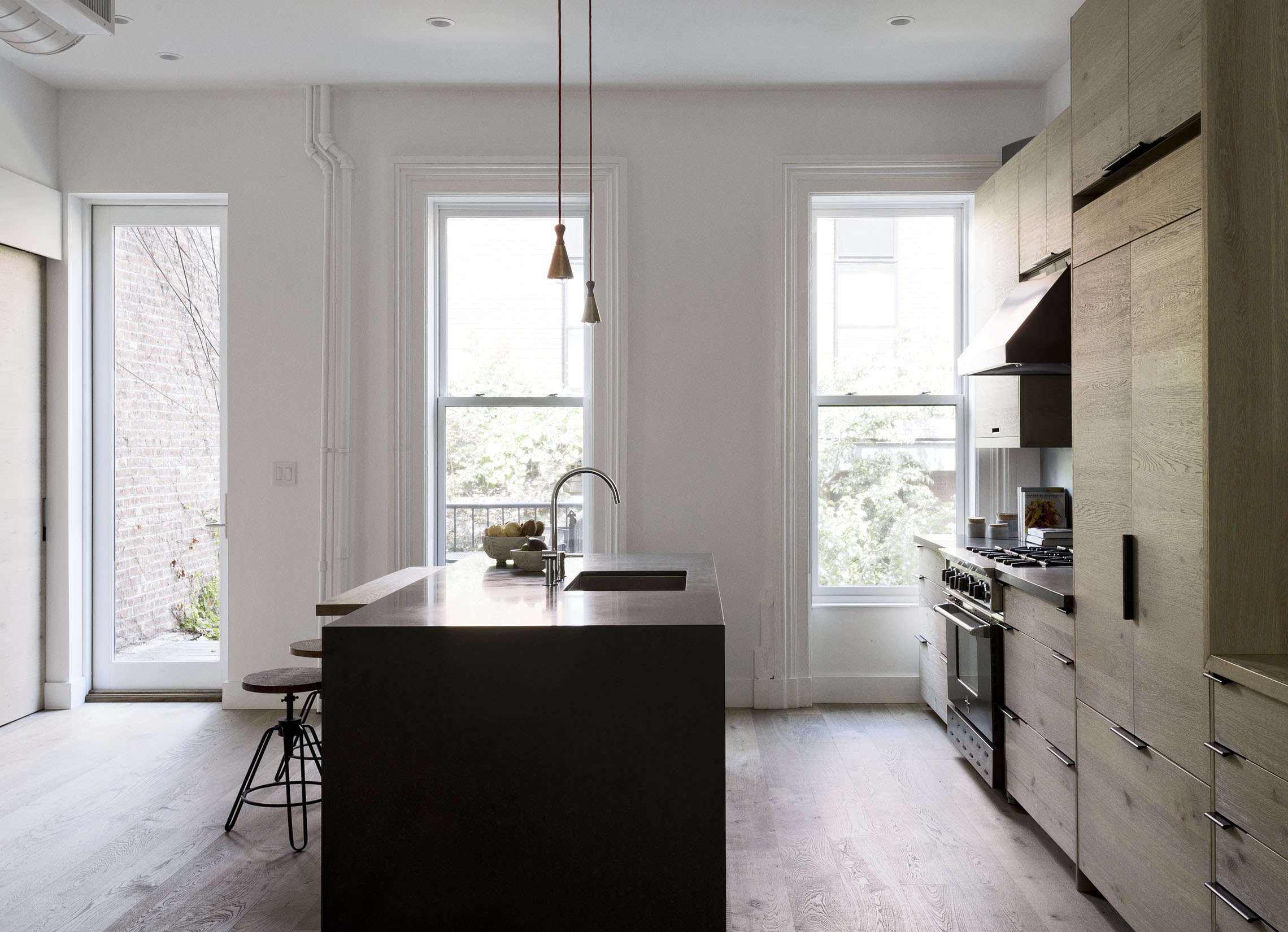 Brooklyn kitchen design with custom wood cabinets and quartzite island by Workstead, Matthew Williams photo | Remodelista