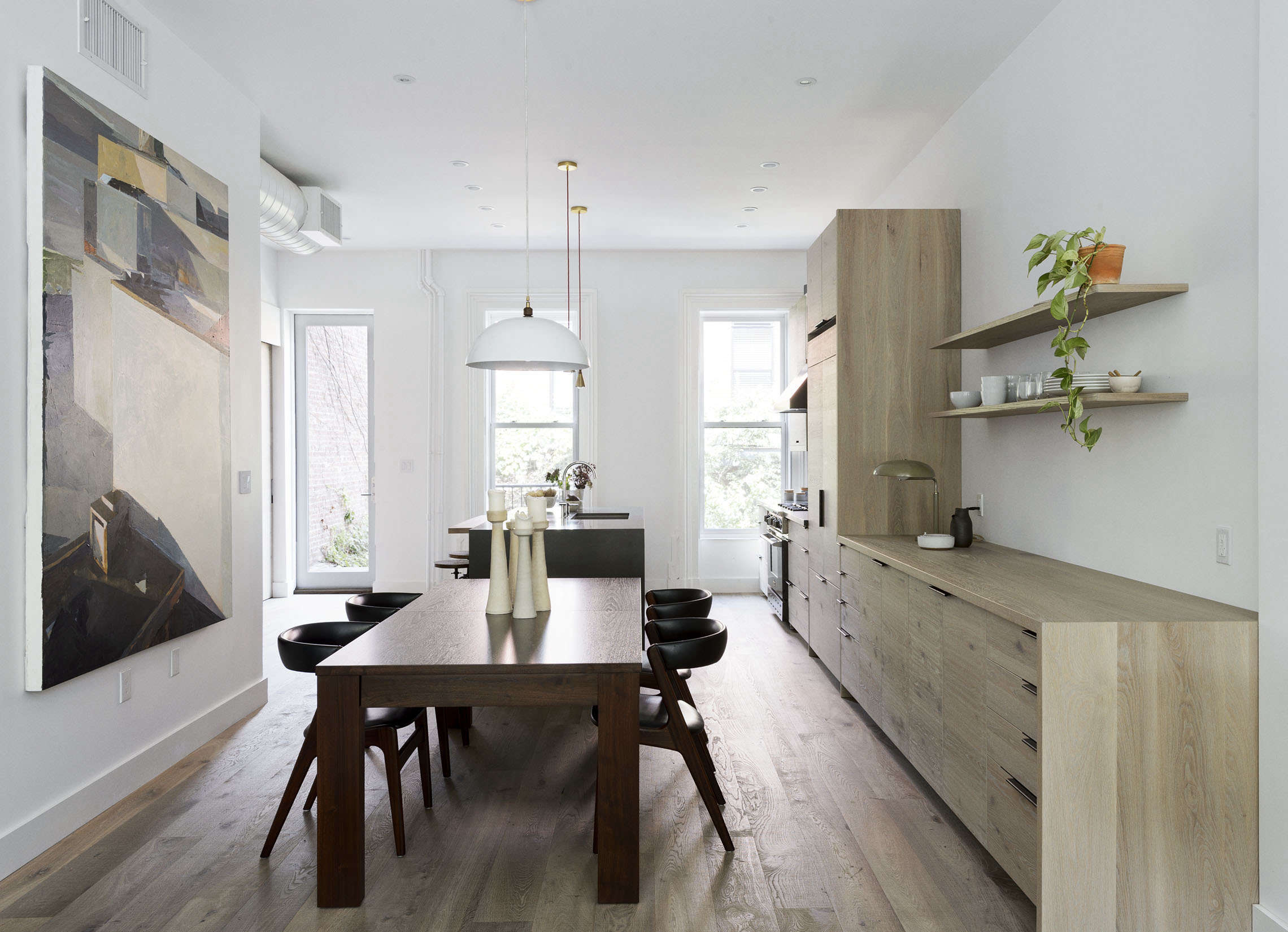 Dining area in a Brooklyn kitchen remodel with custom oak cabinets, design by Workstead, Matthew Williams photo | Remodelista