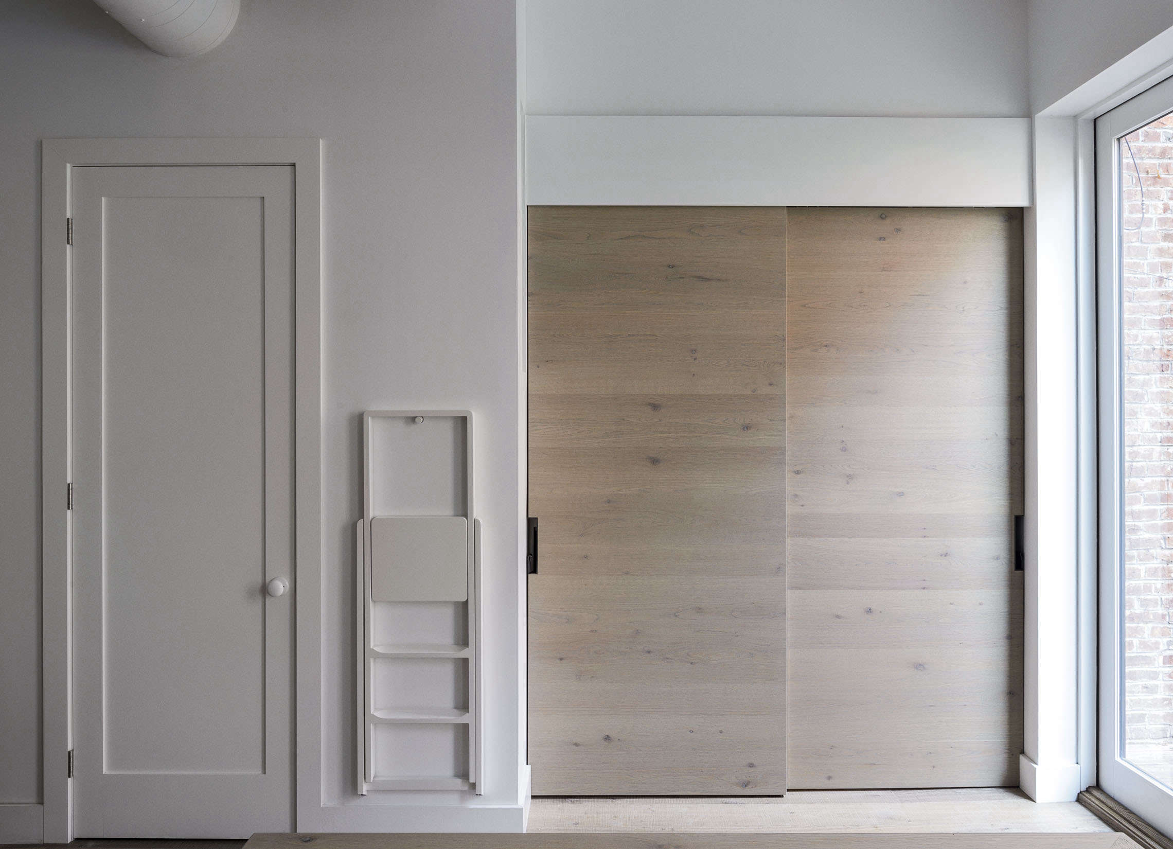 Concealed modern pantry in a Brooklyn kitchen remodel by Workstead, Matthew Williams photo | Remodelista