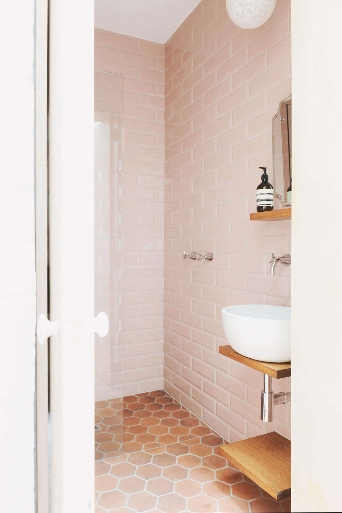 Rethinking pink 9 bathrooms in blush tones remodelista Images of bathroom tile floors
