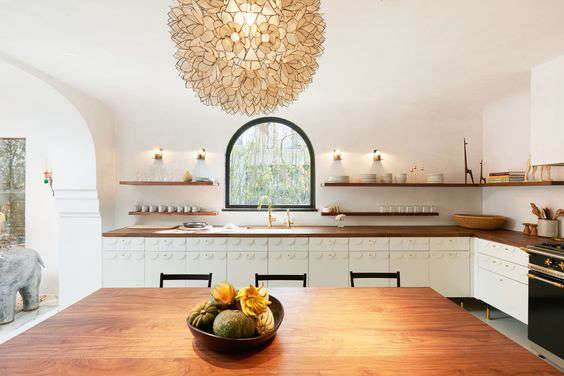 A glam eat-in kitchen in the Irene Neuwirth jewelry boutique kitchen in LA by Commune Design|Remodelista