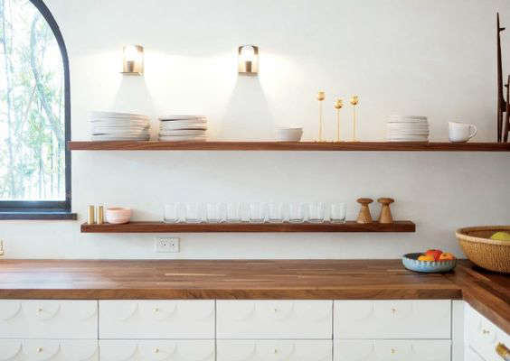A glam eat-in kitchen in the Irene Neuwirth jewelry boutique kitchen in LA by Commune Design, photo via Bon Appetit|Remodelista