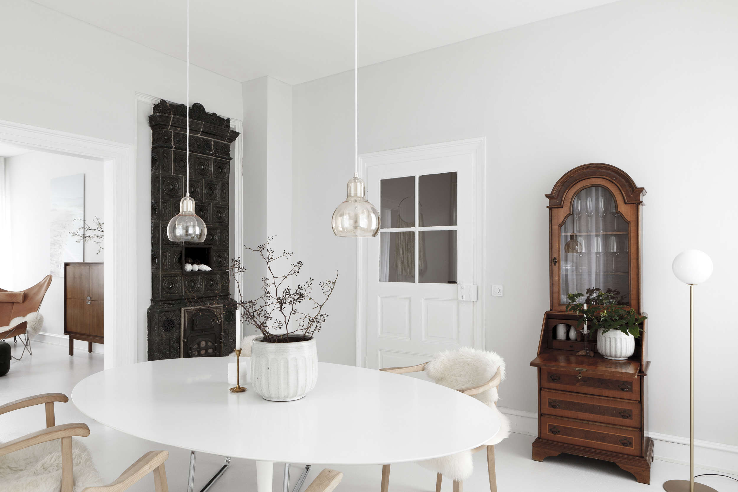 White dining room in a luxe-minimalist apartment remodel by Studio Oink in Mainz, Germany | Remodelista