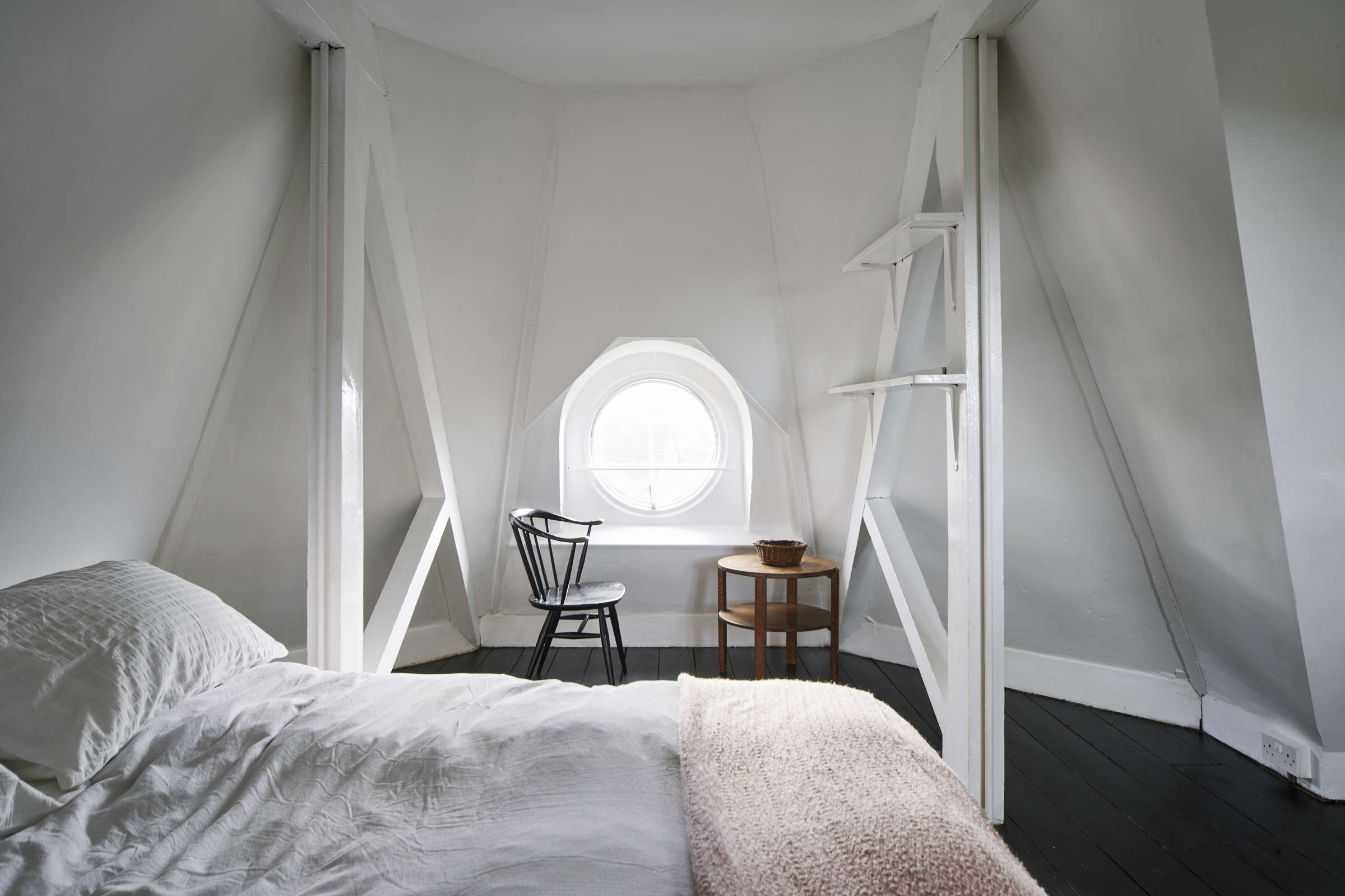 Above a circular oeil de boeuf window in the top floor bedroom