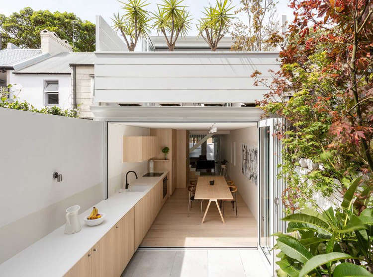 &#8\2\20;The mandate was to turn the structure into a home of abundant natural light and well-proportioned spaces,&#8\2\2\1; say the architects. &#8\2\20;Our strategy revolved around the insertion of a delicate steel staircase that the kitchen grows out of. We treat the kitchen as a core space by placing it between two of the main light sources, the rear courtyard and the stairwell. Its seamless connection to the living room and courtyard on either side provides a sense that these spaces are an extension of the kitchen.&#8\2\2\1;