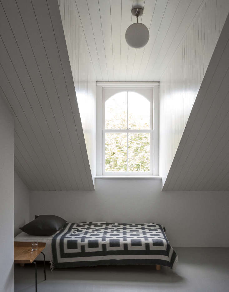 a scandinavian blanket in the attic guestroom of a brooklyn townhouse remodel 9