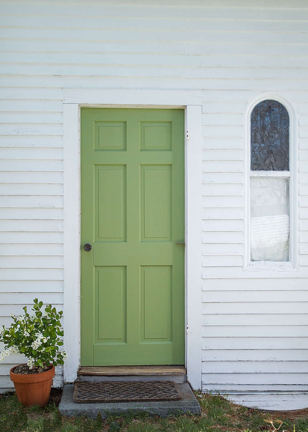 A spring green door with farrow ball paint remodelista for Green ground farrow and ball